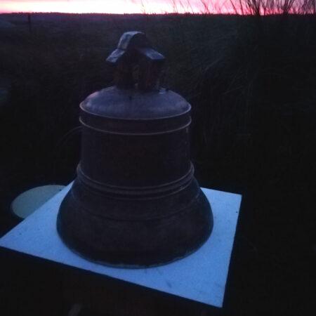 16 De klok in brons in het ochtendlicht